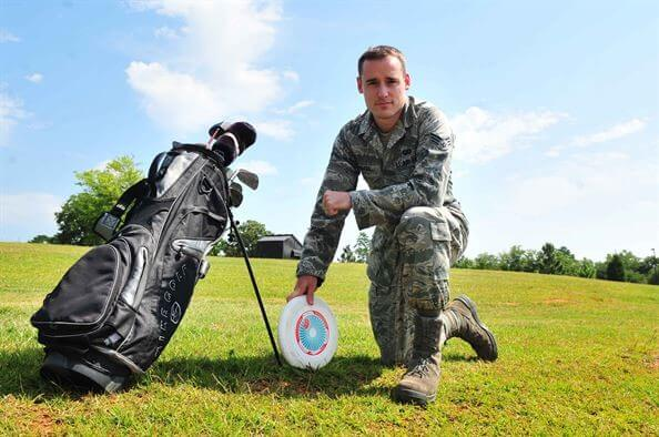 Airman with golf bag