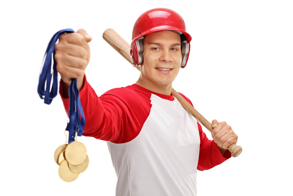 Baseball player holding gold medals