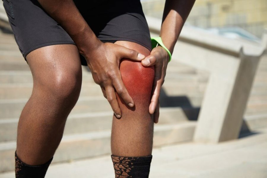 Cropped shot of legs of African sportsman