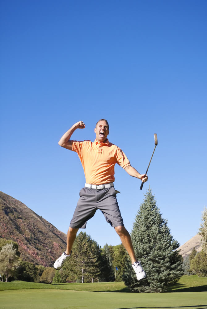 Excited Golfer jumping in the air