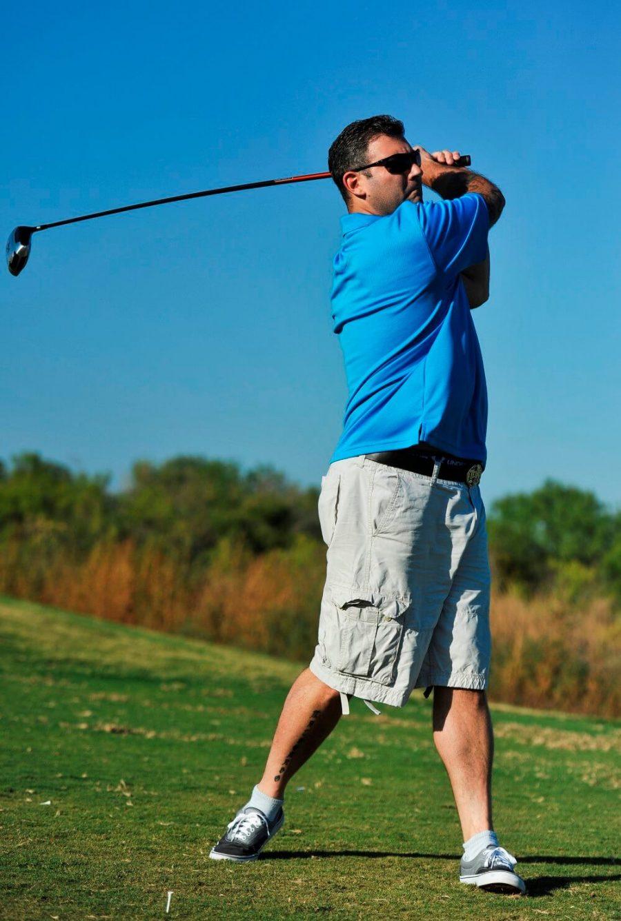 Golfer in blue shirt