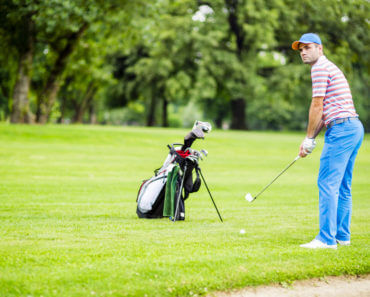Golfer practicing and concentrating