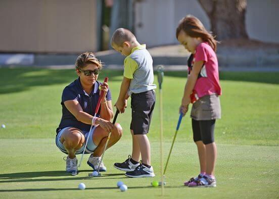 Kids learning golf