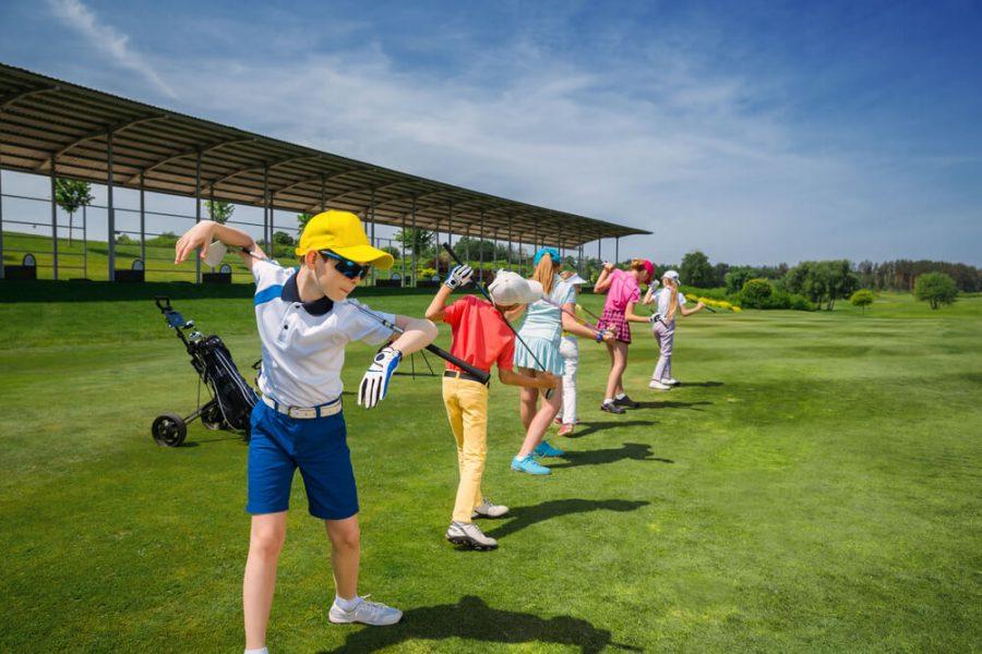 Kids warming up at golf school