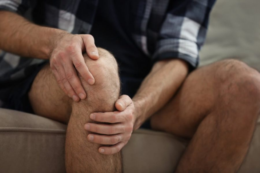 Man feeling pain in his knee