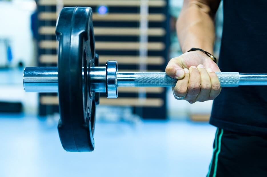Man with training equipment on sport gym