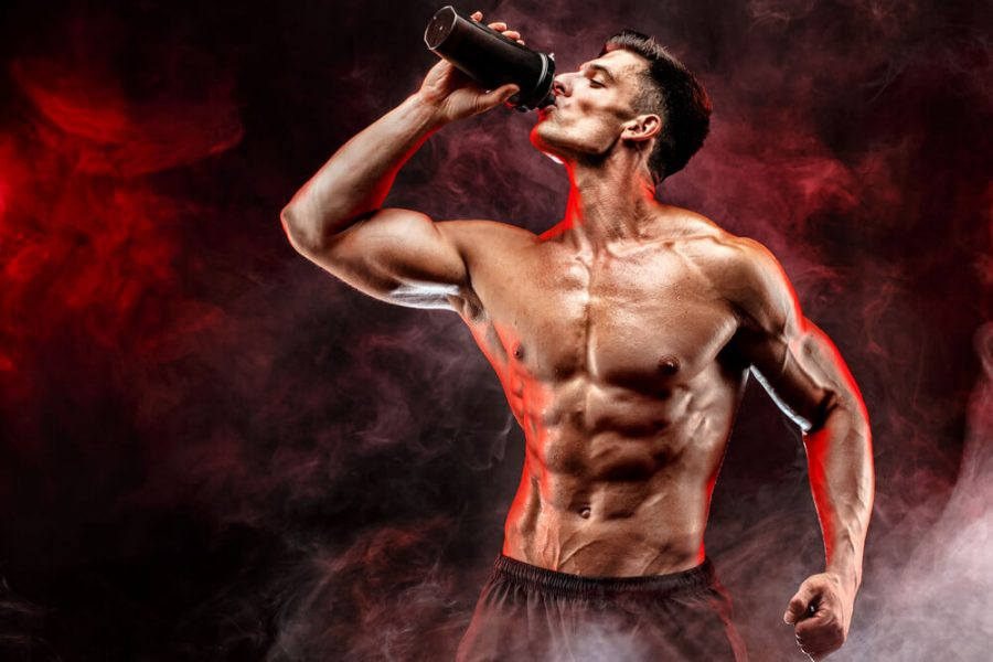 Muscular man with protein drink