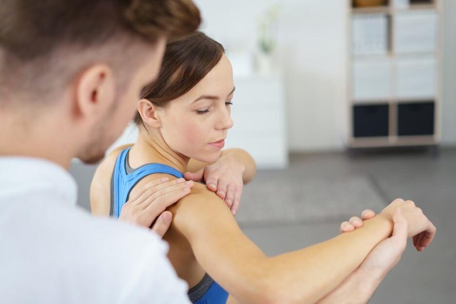 Orthopedist Massaging the shoulder