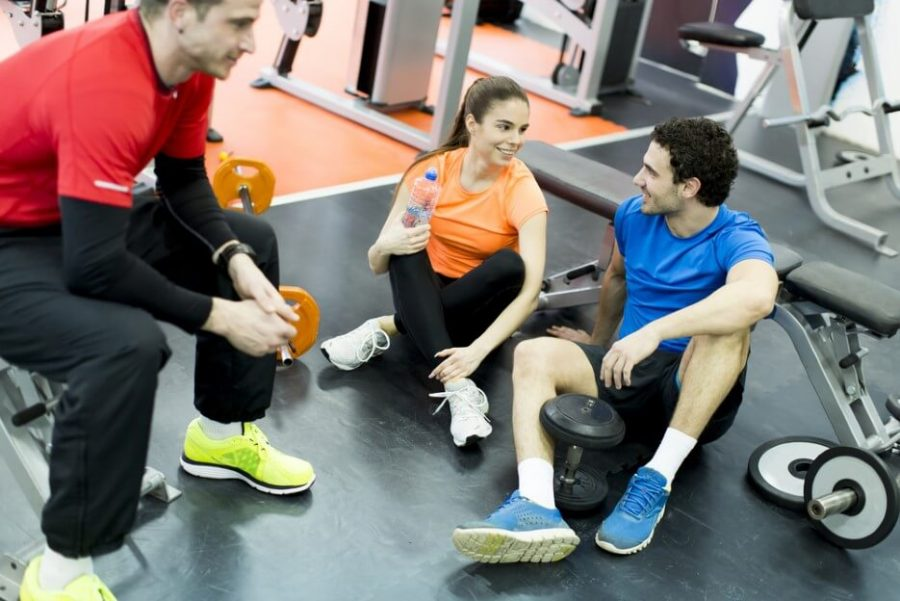 Young people resting at gym