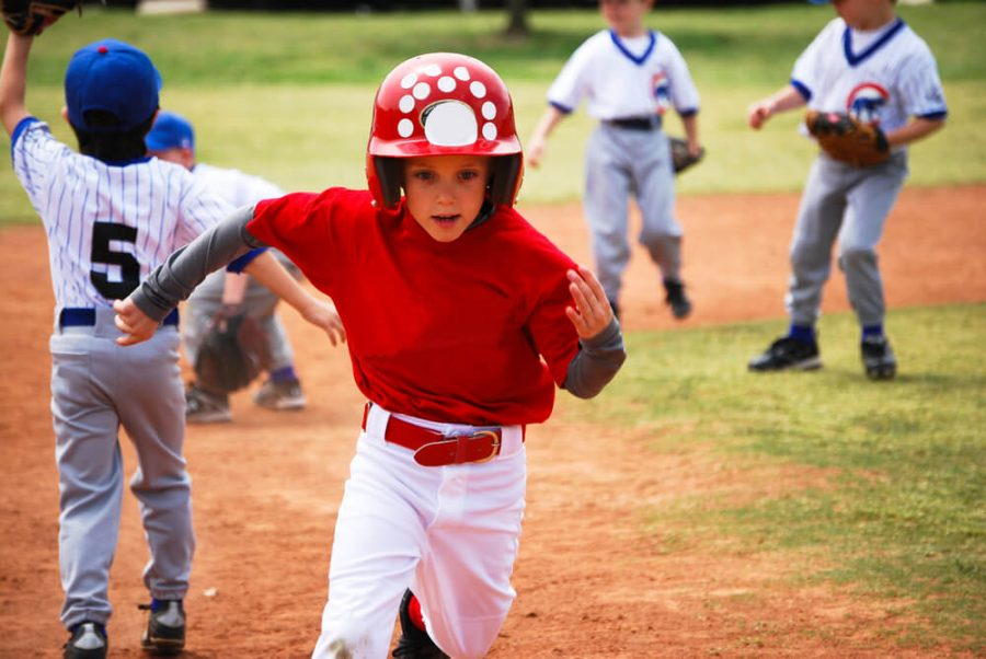 Youth baseball boy running bases