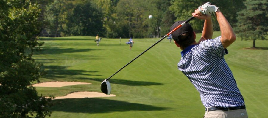 a guy playing golf
