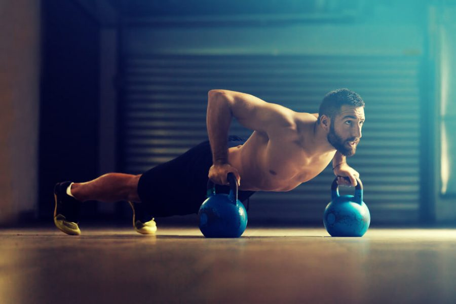 fitness man is training by kettlebell