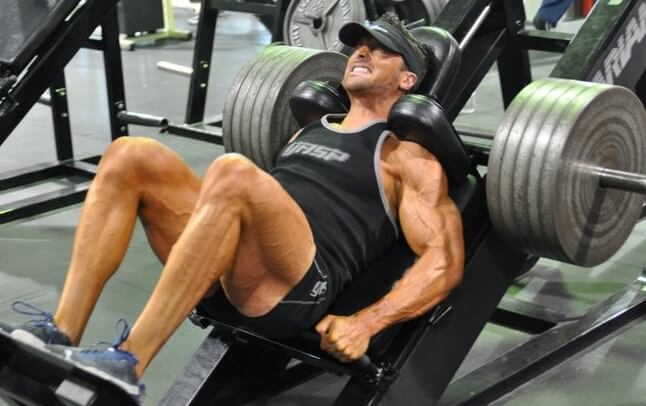 a man doing a reverse leg press