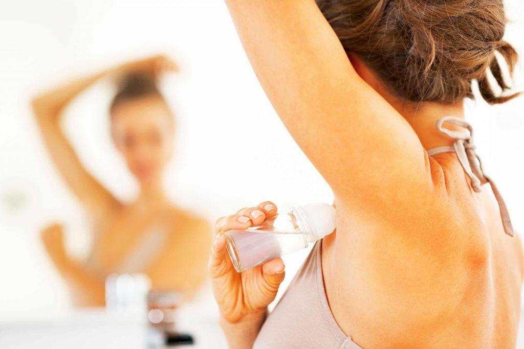 Girl using deodorant