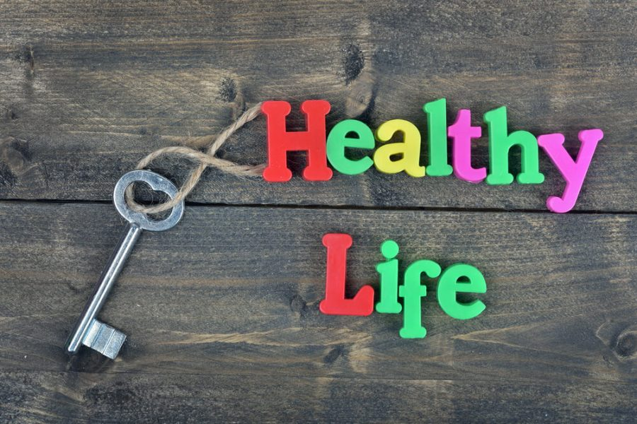 Healthy life word on wooden table