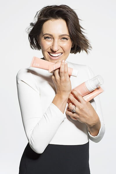 Woman holding creams