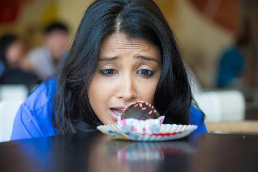 desperate woman in blue shirt craving fudge