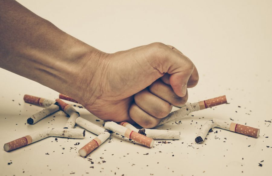 hand destroying cigarettes