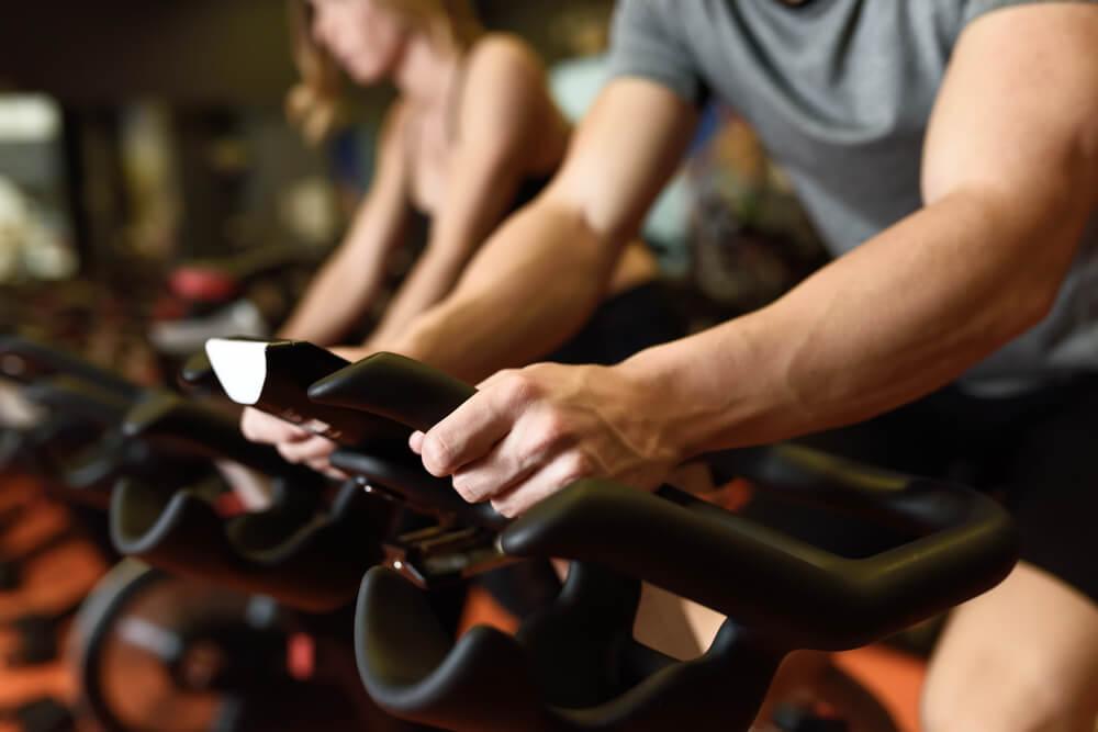 man biking in the gym