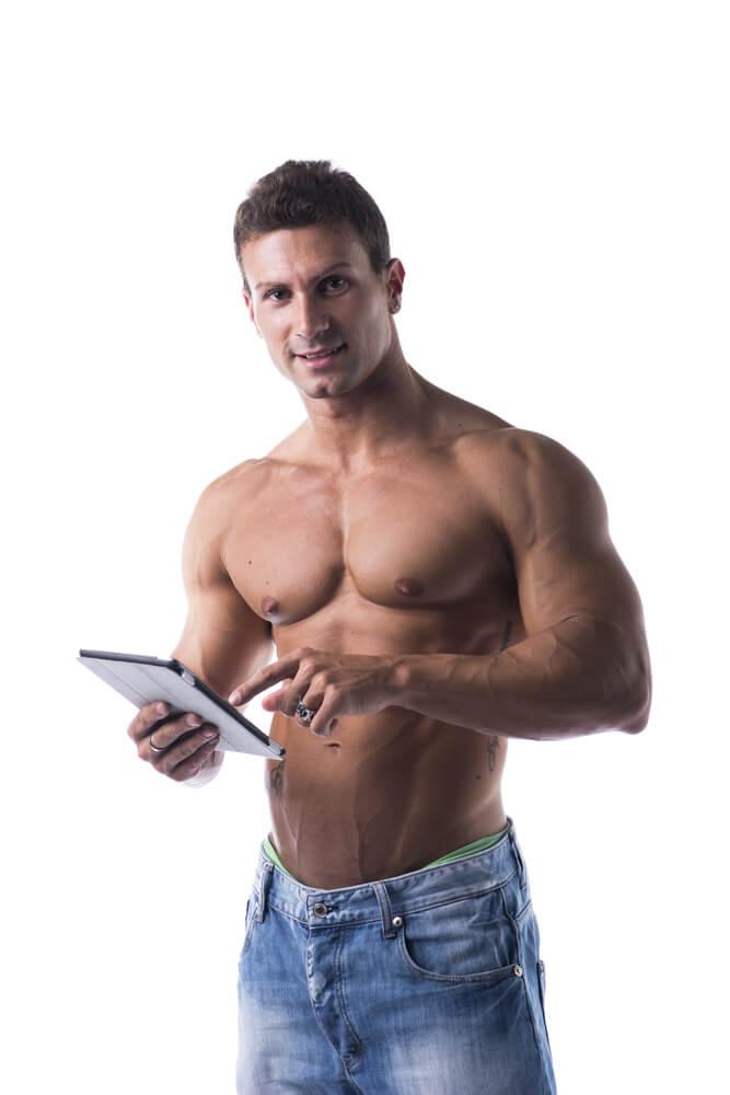 male bodybuiler holding ebook reader
