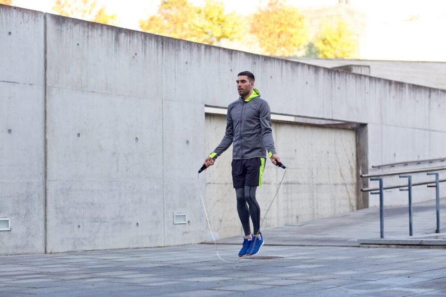man exercising with jump-rope outdoors