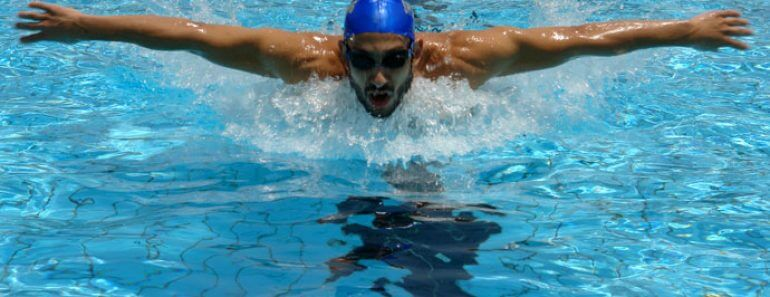 man practicing how to swim