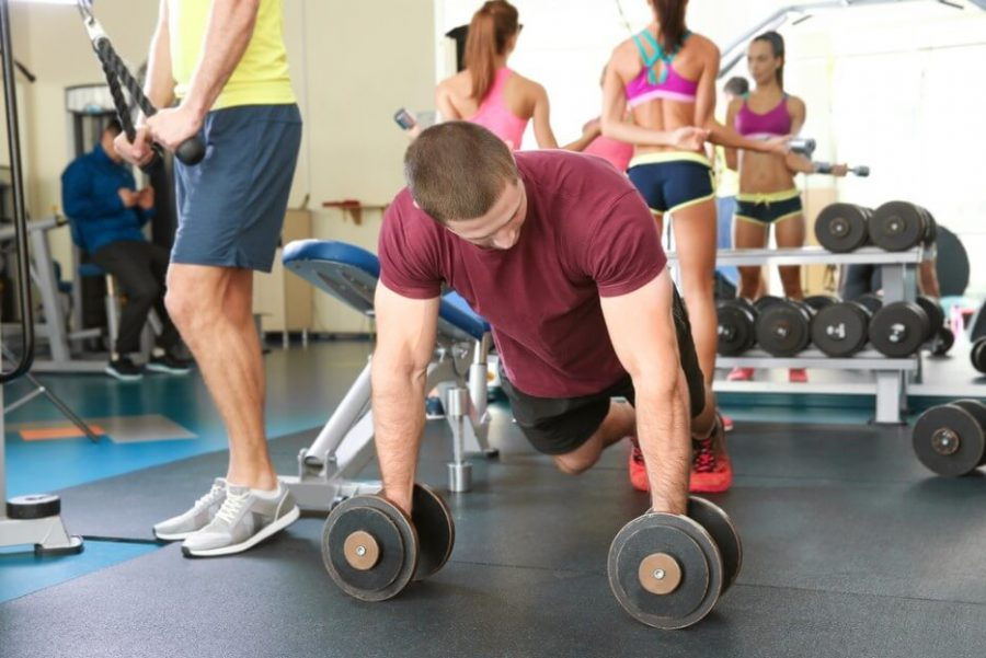 man with dumbbells training in gym