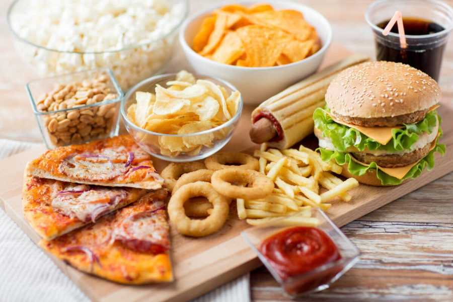 fast food and unhealthy eating concept - close up of fast food s