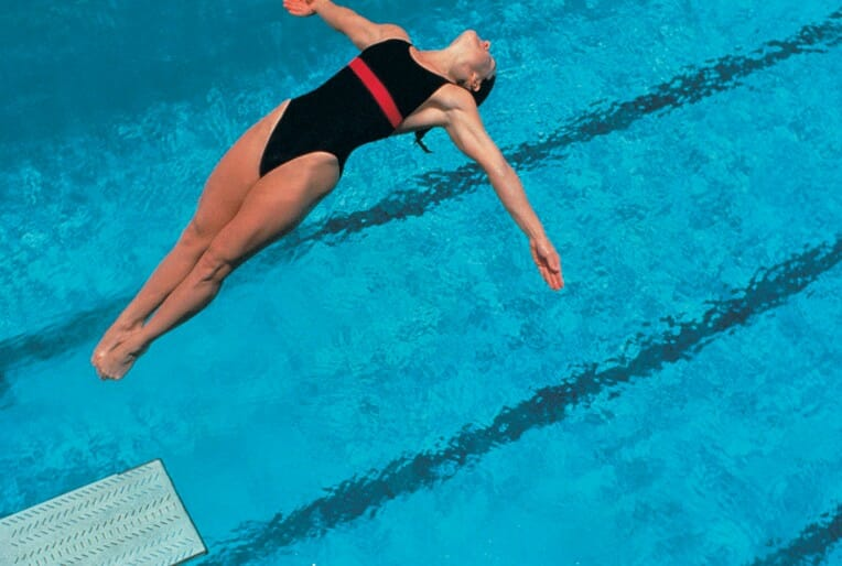 woman doing a swimming technique