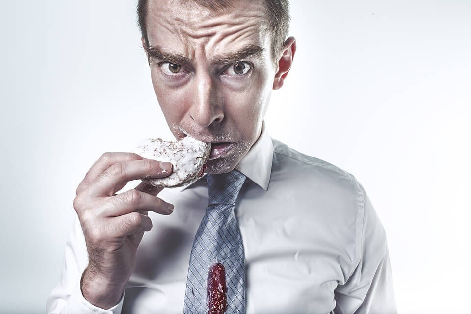 Hungry man eating a cookie
