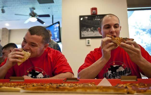 Men eating pizza