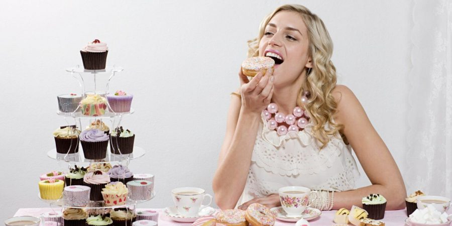 a person eating cupcakes