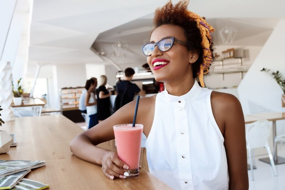 african girl drinking smoothie