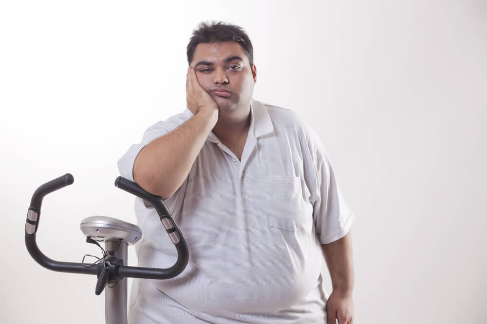 obese man with an exercise bike