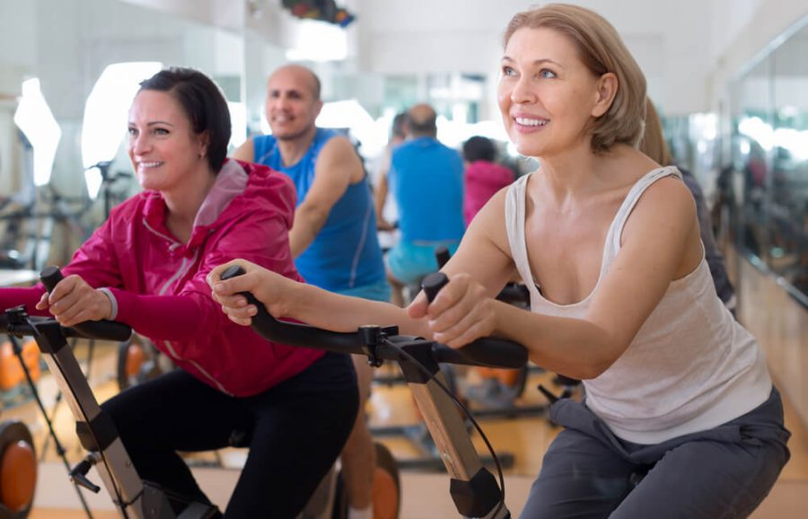 older people do sports on exercise bikes