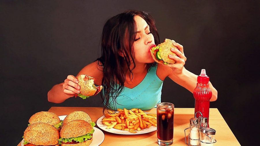 woman eating a lot
