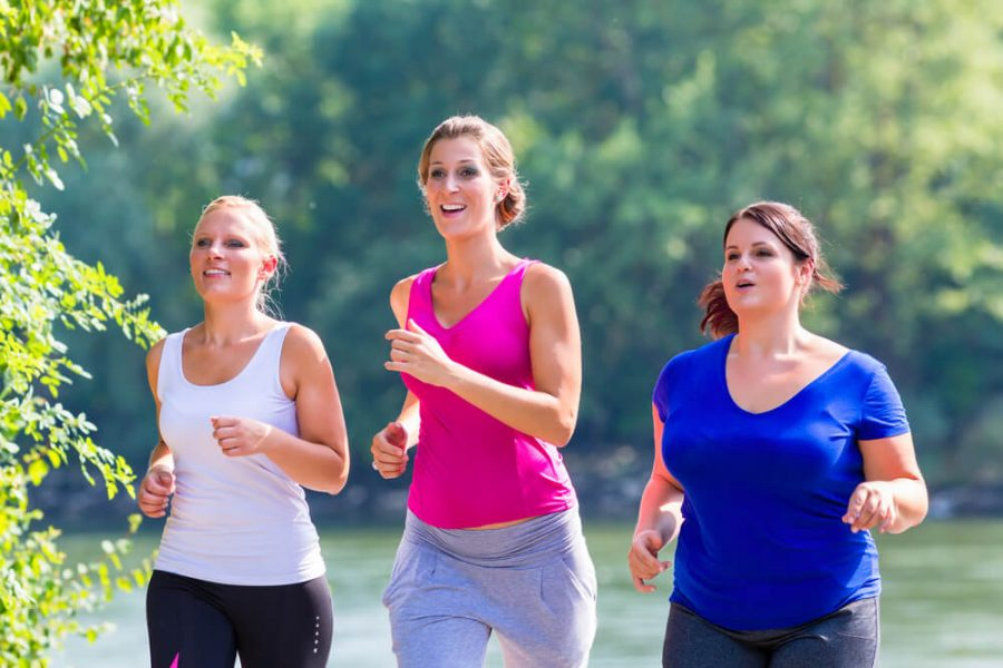 women running at lakeside jogging